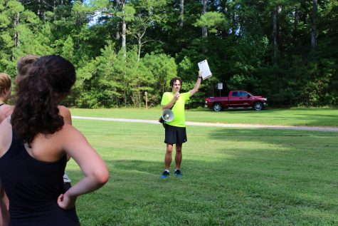 Running the show: New head coach Huff inspires cross country team