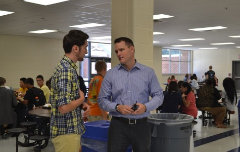 Mr. Revard discusses vision for The Tribe app with junior Alex Flack.