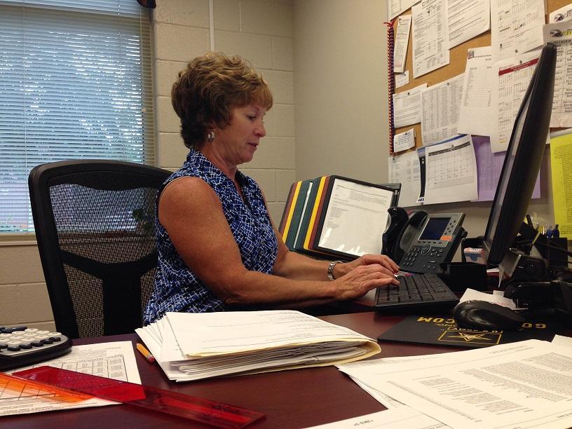 Mrs. Parisay, school secretary, handles the majority of dress code violations.