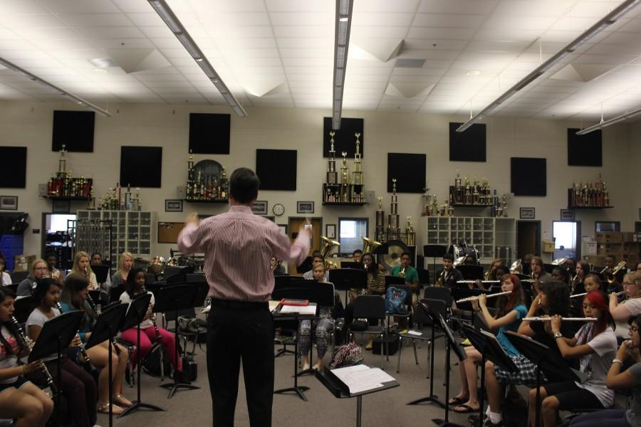 Band+director+Mr.+Williams+prepares+his+protoges+for+the+upcoming+performances+that+debut+their+new+football-centric+theme.+