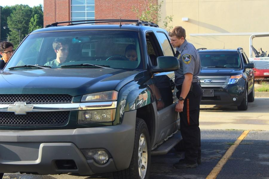 "Explorer Birkett and Cervantes approach the car carefully, as Birkett checks the drivers' license. This is an important factor in traffic stops. ""Its fun to improvise and mess with the acting officers."""