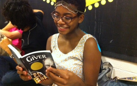 "Senior Krystal Washington enjoys Lois Lowry's novel The Giver in preparation to see the book's recent film adaptation. ""The Giver"" won the 1994 Newbery Medal and has sold more than 10 million copies."
