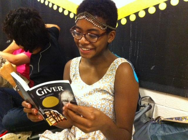"""Senior Krystal Washington enjoys Lois Lowry's novel The Giver in preparation to see the book's recent film adaptation. """"The Giver"""" won the 1994 Newbery Medal and has sold more than 10 million copies."""