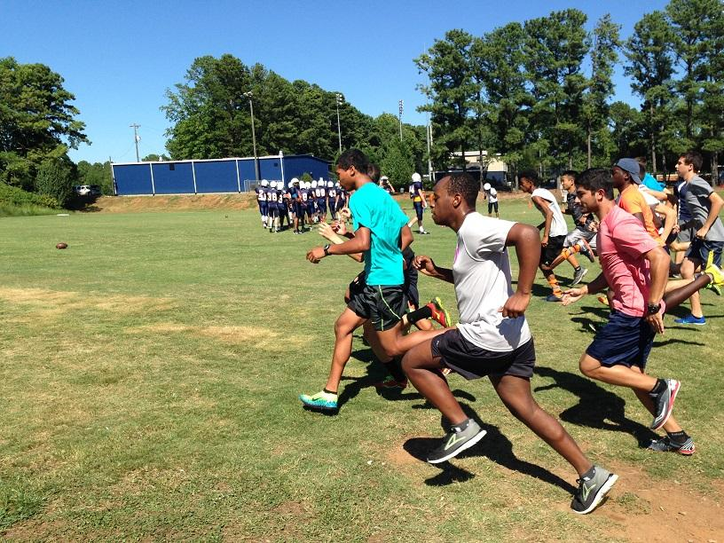 Cross country runners prepare for their next race by completing time trials.