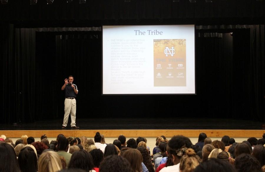 """Dr. Page introduces and explains """"The Tribe"""" to senior girls during their class meeting on August 14."""