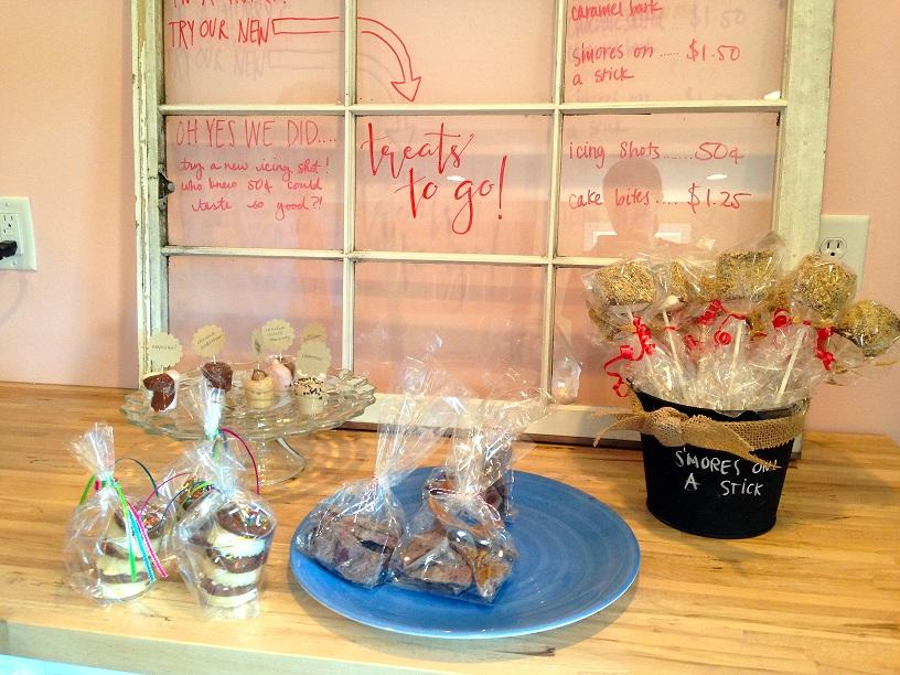 One part of the store focuses on these take-away treats. Some of the choices include icing shots, s'mores on a stick, and cake bites.