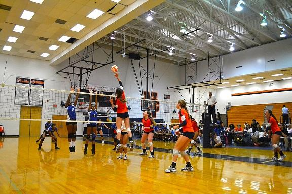 Senior Abby Miller jumps to block.