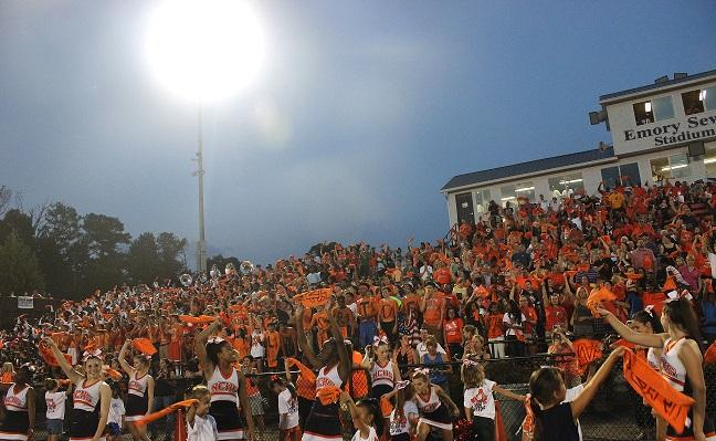 Warriors sported their school colors in the Orange Out theme in the student section on September 5 against Cartersville.