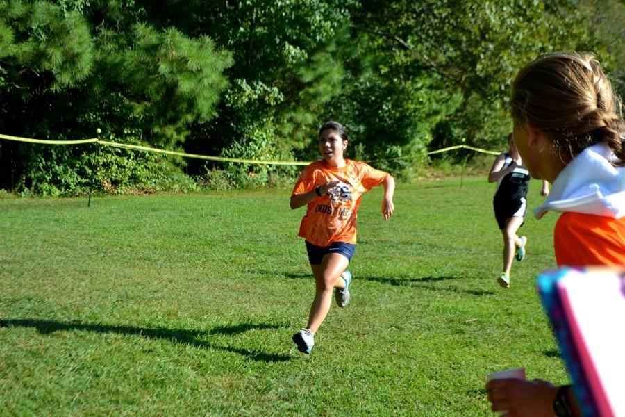 Junior Karen Ponce completes the last 100 meters of the race, and finishes 15th for North Cobb girls.