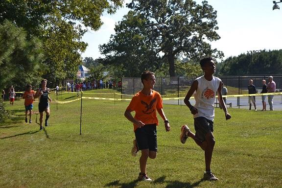Sophomore Dillen Ivans and freshman Anthony Graham complete their first mile in the 5K. They have two miles left to run until they finish.