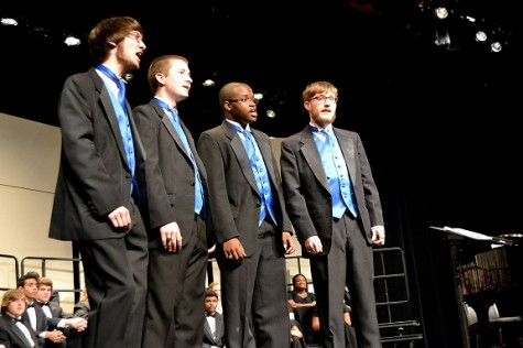 "North Cobb's quartet, made up of seniors Chris Elsey, Isaiah Alexander, Cain Henderson, and Andrew Smart, gather around the edge of the stage, belting out ""The Headless Horseman"" with an old-fashioned gusto."