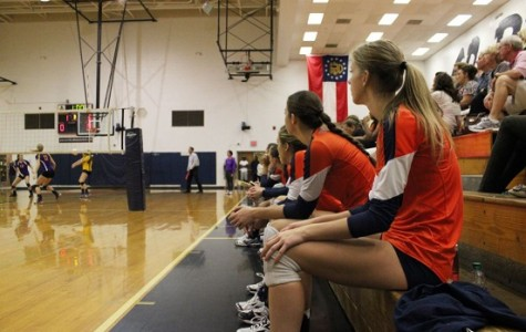 Lizzy Daniel and team watch the action during a game her junior year.