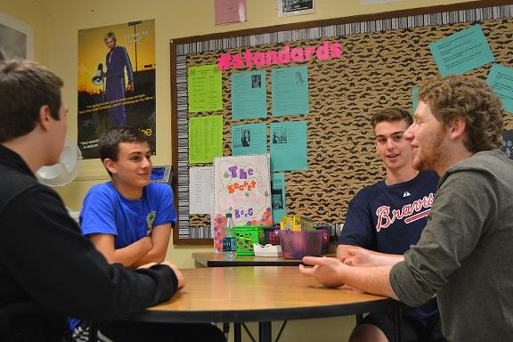 Left to right: Senior Sam Fulkerson, sophomore Emmett Schindler, senior Cameron Hines, and junior Adam Kovel serve up their predictions in a sports roundtable debate over who will take the World Series tonight.