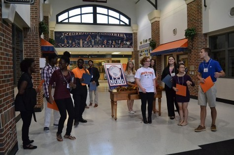 "Various Magnet students waited for visitors to enter North Cobb. ""We were the ones who handed them their folders and walked them to the theater for their presentations,"" said sophomore Marie Ow. ""We got to talk to them on the way there and promote the program. It was really fun!"""