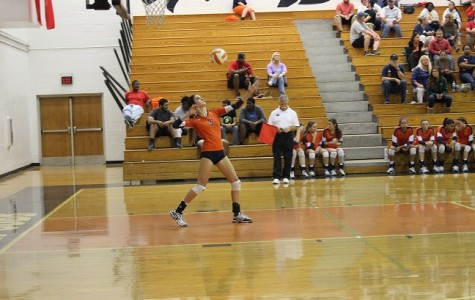 """Senior Abby Miller delivers a powerful serve. """"We started out playing Mountain View unsure of the outcomes, but we came together as a team and fought through the entire match,"""" Miller said."""
