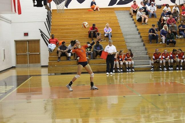"Senior Abby Miller delivers a powerful serve. ""We started out playing Mountain View unsure of the outcomes, but we came together as a team and fought through the entire match,"" Miller said."