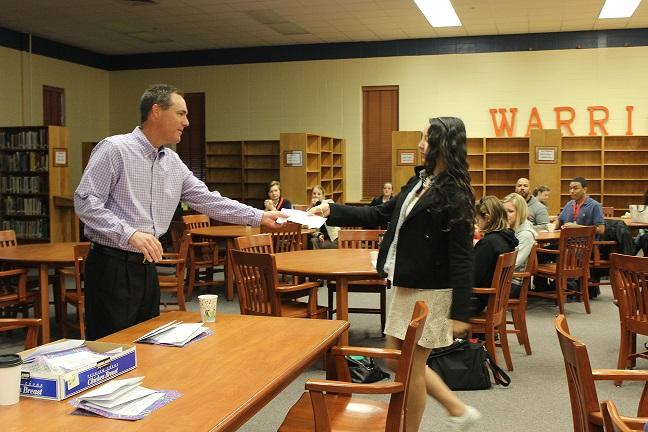 Dr. Page presents sophomore Anastasia Goodwin with her certificate for Reflections.