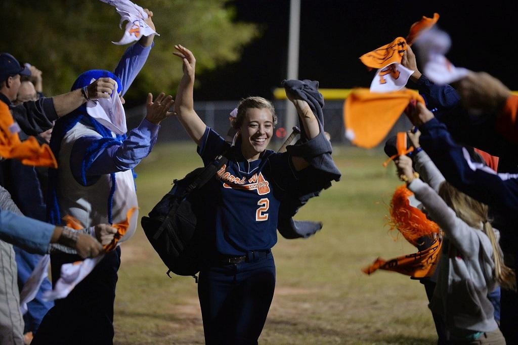 Senior Casey Page celebrates the end of a triumphant season with the team's supporters.