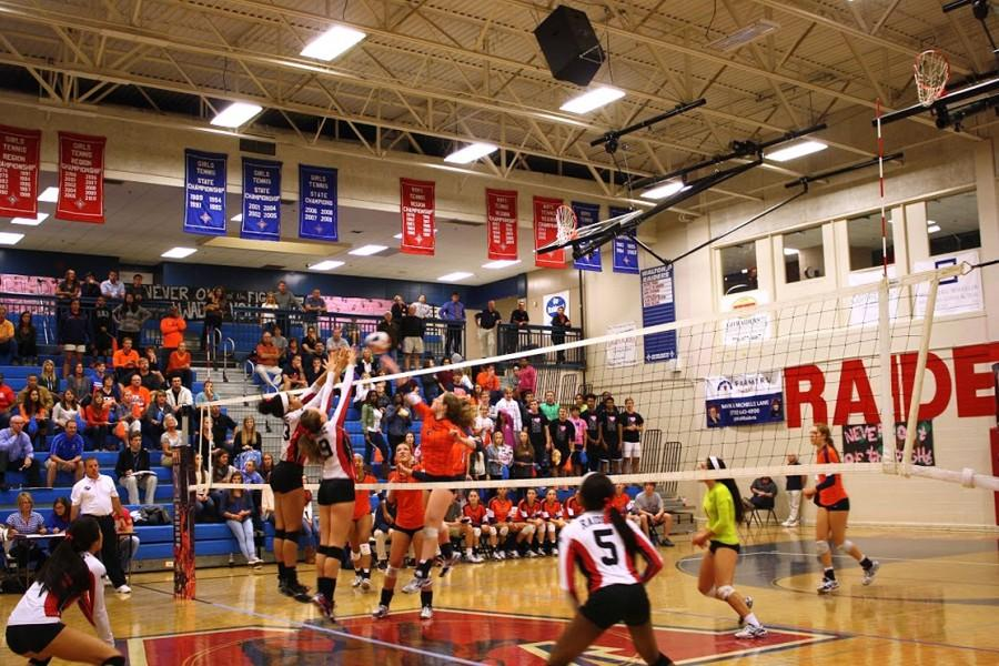 Number two, sophomore Jenna Woodruff, blocks a spike from a Walton Raider. Woodruff finished with eight kills as the Lady Warriors won four match sets to end the Walton's four year reign as number one.