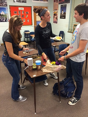 Junior Spanish Club members RJ Anderson, Riley O'Neill and Grant Westbrook share a laugh while creating tasty breakfast burritos.