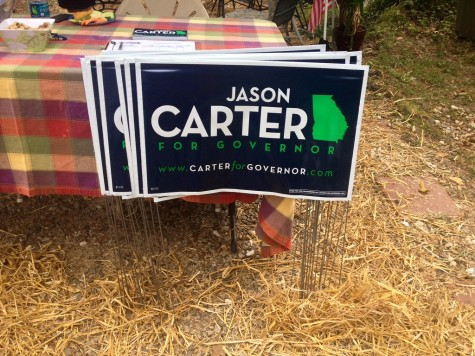 With the election just weeks away, Jason Carter support signs pop up in neighborhood yards.