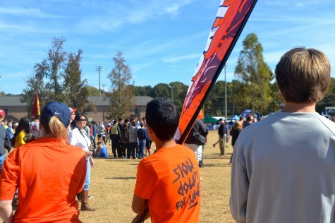 From the far sides of the course, the North Cobb flag could be seen to cheer on the boys. Freshman Ginji Ozawa, whose brother Ricky ran in the State race, took on the task of flagbearer.