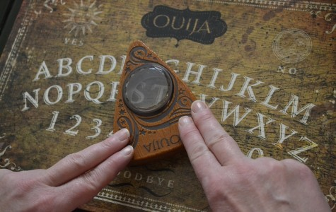 Ouija, released October 24, tries to terrify audiences by perpetuating the myths and superstitions associated with a board able to contact the dead.