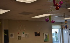 Ms. Ryan's AP Physics classes gets ready for the up-and-coming holidays by using ornaments and candies to decorate one of their final assignments. The students tied them on a variety of colorful sticks using green and red pieces of yarn, balancing all the components of the project. Ms. Ryan hung them up in her classroom over the weekend to liven up the room and hopefully spread some holiday cheer to her other students.