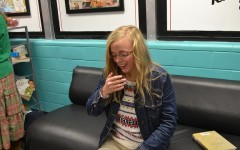 """Senior Rachel Mockalis sneezes as she eats lunch, making sure to cover her mouth. """"I've been sick for three days, and I wish I wasn't at school but it's not that bad. I just hope I don't get anyone else sick,"""" she said."""