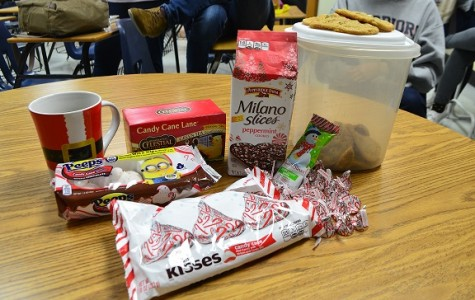 """On Friday, December 12th, reporter Anabel Prince brought various delights with peppermint ingredients mixed into them for her and the newspaper staff to taste. The treats used in the experiment were peppermint green tea, peppermint peeps, peppermint milano slices, peppermint cookies, peppermint bark, and peppermint chocolate hershey kisses. While the students gobbled up the delicious treats, Anabel took notes on the taste and decided whether she loved or hated the edible items. """"Out of all the food, the hershey kisses were my favorite,"""" senior photographer Morgan White commented."""