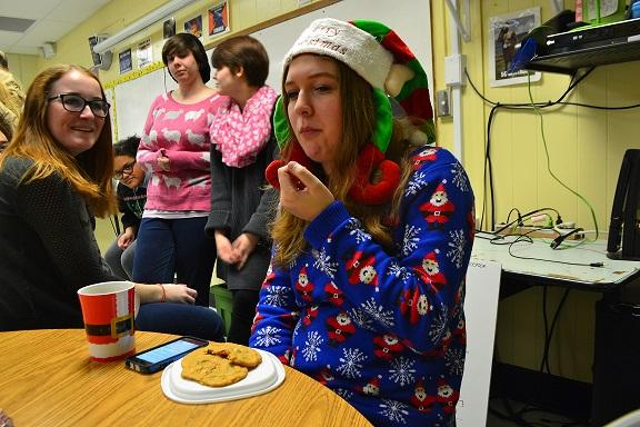 """While wearing her adorable tacky Christmas sweater and hilarious elf hat, Anabel Prince contemplates whether she loves or hates the delicious-looking peppermint treats she brought to taste test. """"I'm normally not the biggest fan of peppermint things, but surprisingly the reason I didn't like most of the foods was because they were overly sweet,"""" Prince described."""
