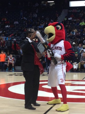 Harry the Hawk is on the court with the widely known t-shirt cannon and is shooting the shirts to fans.