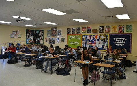 A-day students of Mrs. Buckert's 10th grade Magnet World Lit Bundle jump back into their studies by continuing to read their books in class.