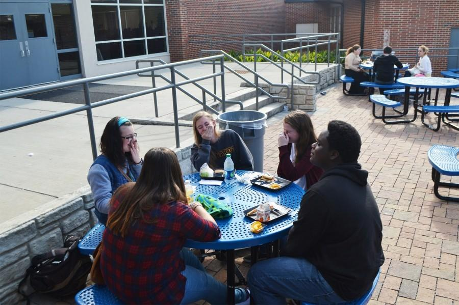 "Laughing hysterically, juniors Sara Moeller, Alison Goddard, Savannah Markham, Anna Coleman, and Jordan Pickett reconnect after the week-long Thanksgiving Break. ""I'm not happy to be back at school but I'm really happy to see my friends,"" said Savannah Markham."