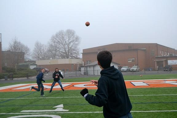 The sports writers play a pick-up game to invoke the NFL spirit in preparation for the Divisional Round.