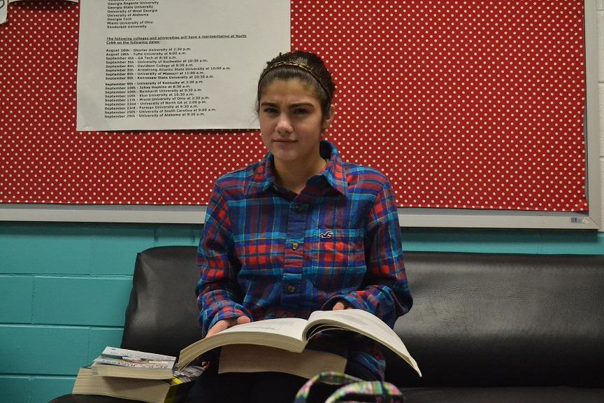 """Junior Rowan Yeni studies for her bundled classes during her lunch period. """"It's really stressful and I don't like having to study during all of my free time because I would want to do other fun things, but I can't,"""" she said."""