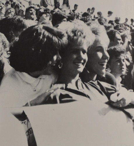 """We're so awesome, we're divine, we're the class '89."" Junior girls cheer and laugh at the 1988 pep rally."