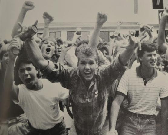 The class of '89 showcases their school spirit by proudly raising their fists at a North Cobb Pep Rally.