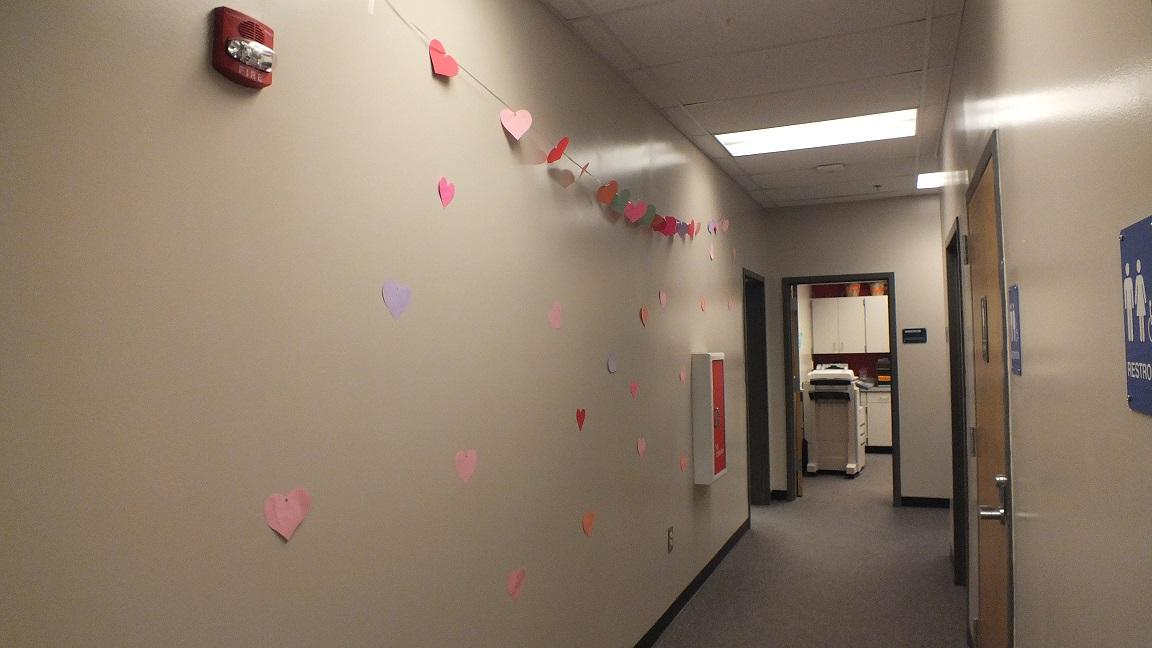 "Move aside China, Admin. 2 is building the Great Wall of Hearts. ""Decorating the office made our work much more fun and got our creative juices flowing,"" said junior Carly Nunez."