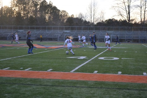 Senior Abbie Duckett dribbles the ball past Campbell Cougars to pass to her teammates.