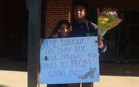"""Junior Manoah Johnson """"promposed"""" to junior Judy Beddawi before first period with flowers, and a poster saying """"You've traveled all over the world… now will you travel to prom with me?"""" She said yes."""