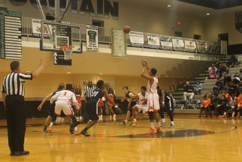 Senior Isaiah Clemons attempts a free throw and succeeds.