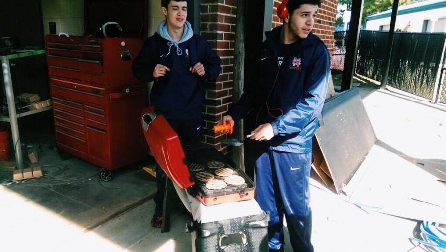 Mr.Squiers, sophomore Juan Martinez, and junior Ethan Williamson cooking out in construction class in celebration of Tradesmen Day, a holiday for all the hard working blue collar workers out there.