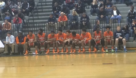 The bench watches in agony as the Warriors fall to McEachern.