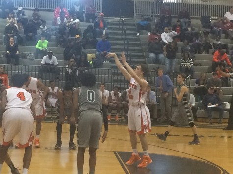 Junior Ricky Shearman follows through as he sinks a free throw.