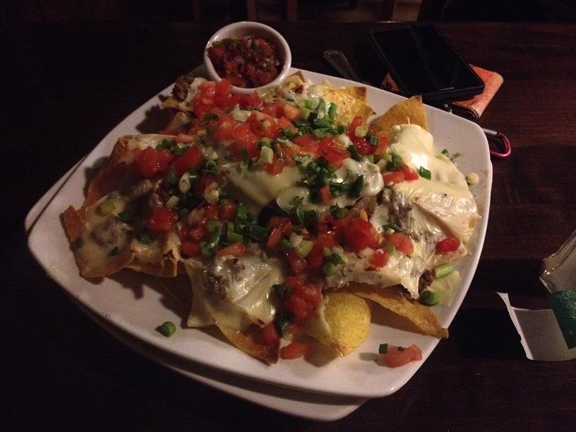 """The Philly steak nachos star a taste that """"touched my soul,"""" said Elizabeth Bush. The nachos possess a heavenly balance of cheese, steak, sauteed peppers, onions, and mushrooms."""