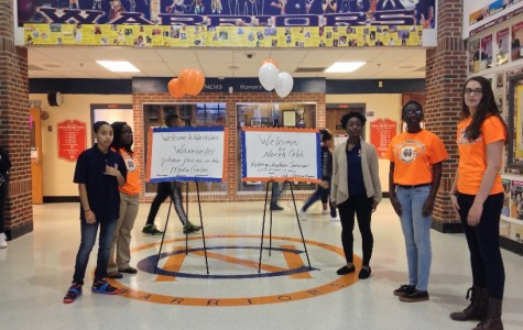 As morning dawned, students dressed in orange and blue stood at doors next to signs illustrating the location of the event. They were placed at the two main entrances as well as in the hallways.