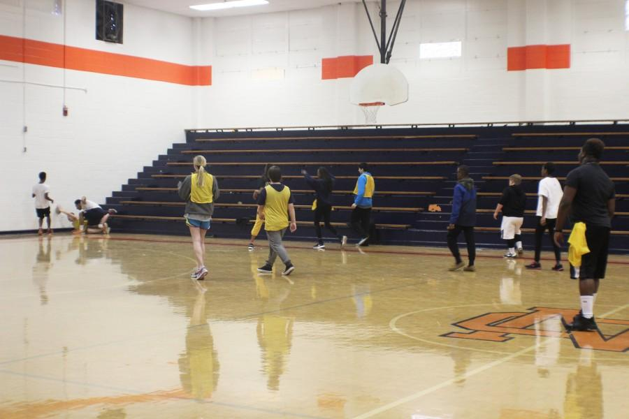 Coach Davis' fourth period personal fitness class splits into yellow and white teams and plays speed football inside the old gym because of cold weather. The yellow team won.