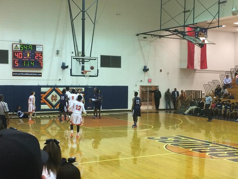 A Marietta guard gets fouled as he drives into the lane.