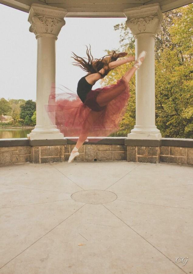 Junior Gina Lee, poses in action mid air with one of her dance moves for a dance photoshoot.